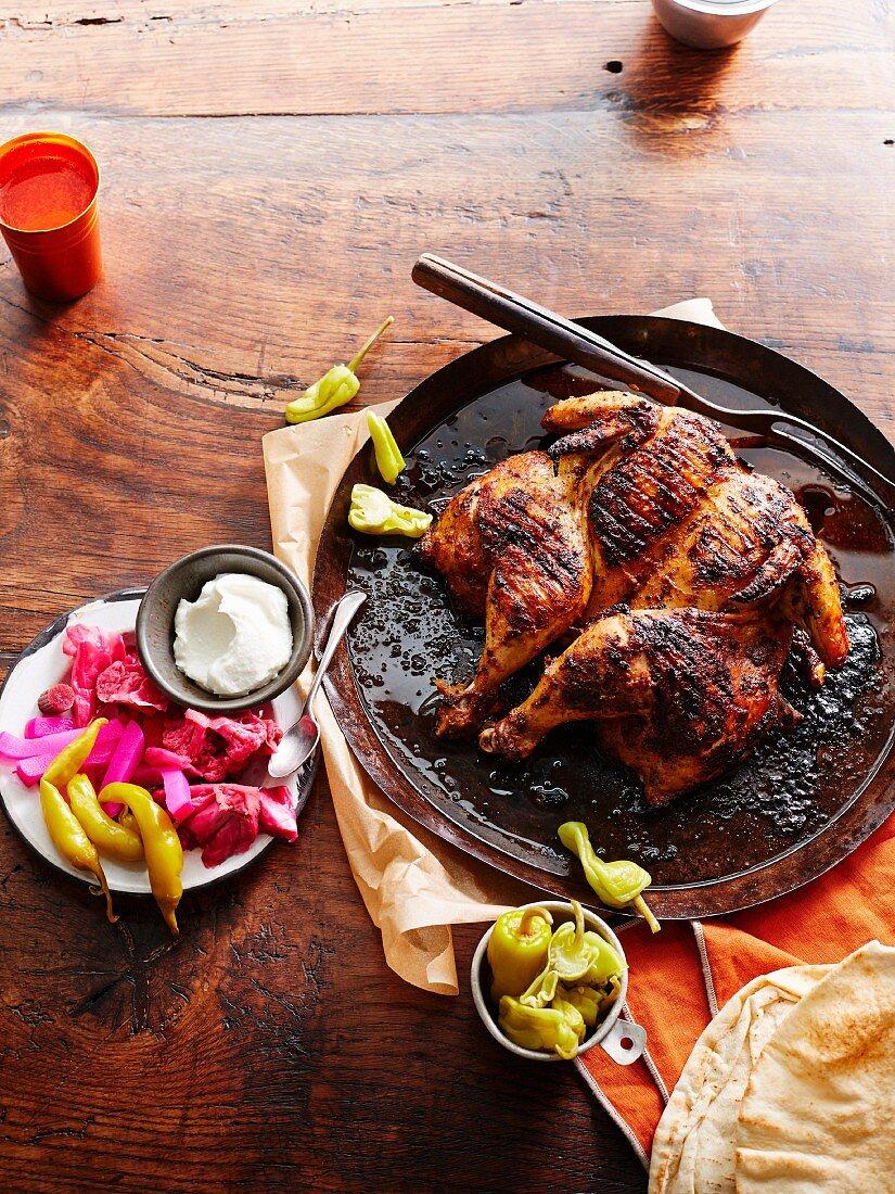 Farouj Meshwe (barbecued garlic chicken, Lebanon)