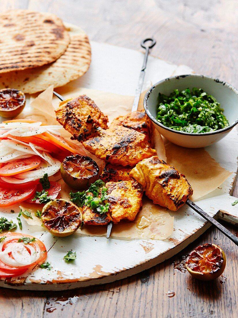 Barbecued tandoori fish skewers with tomatoes