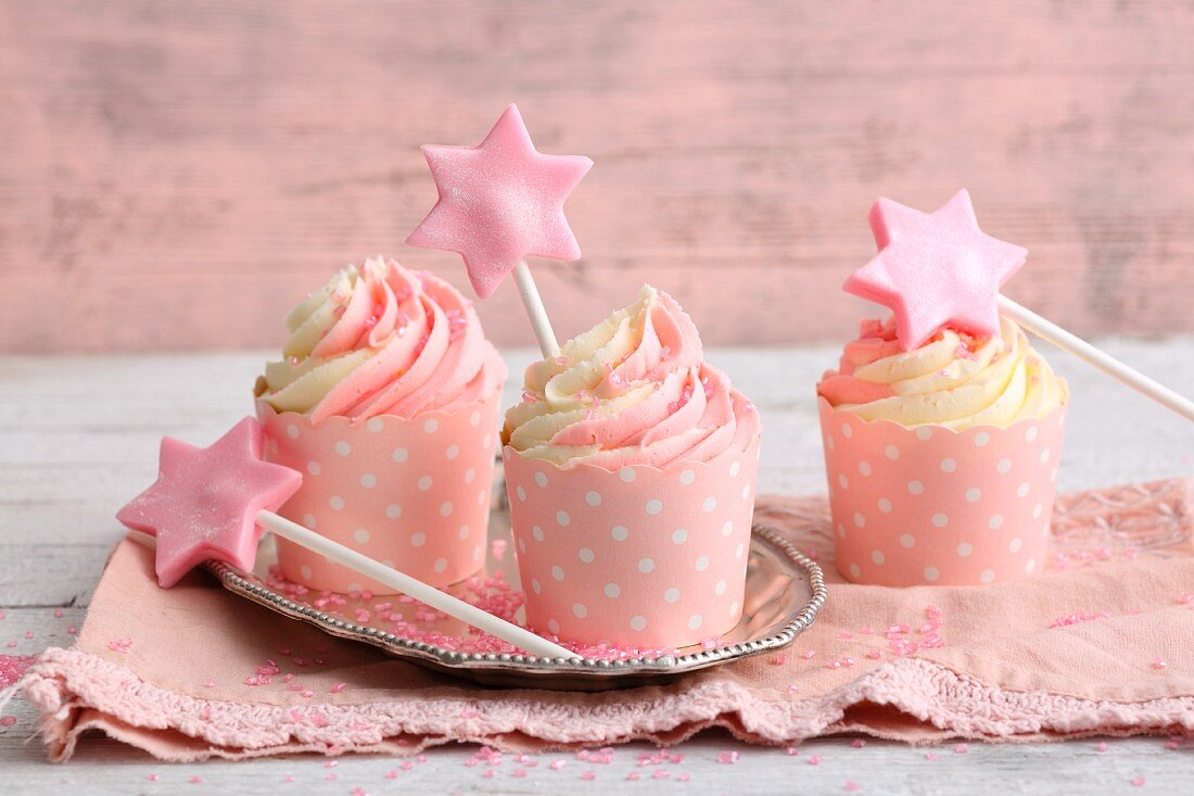 Buttercream cupcakes decorated with glitter for a princess party