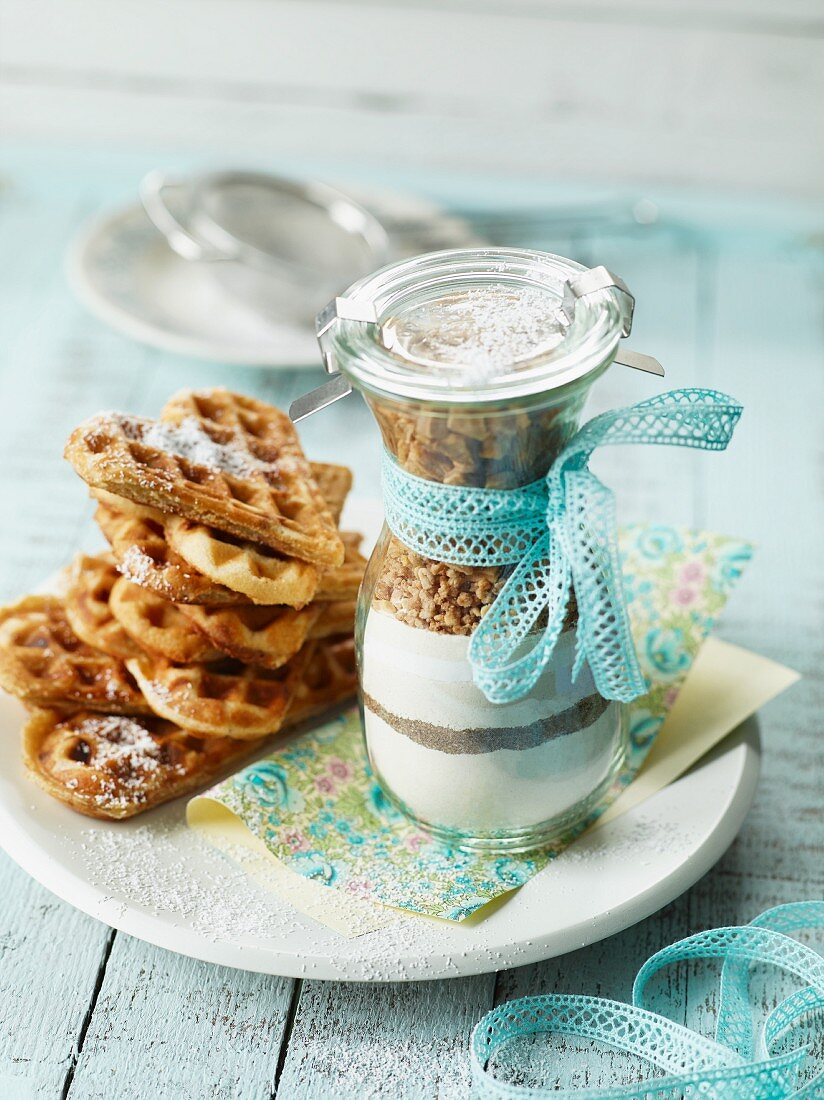 A baking mixture for making apple waffles in a glass as a gift