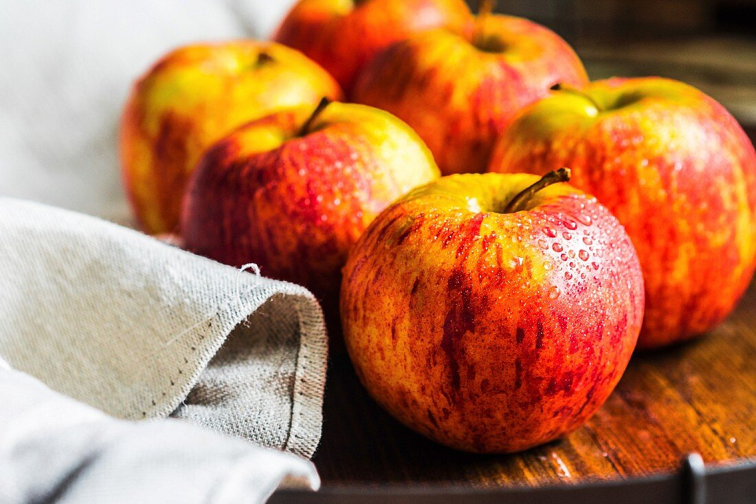 Fresh apples on a wooden surface