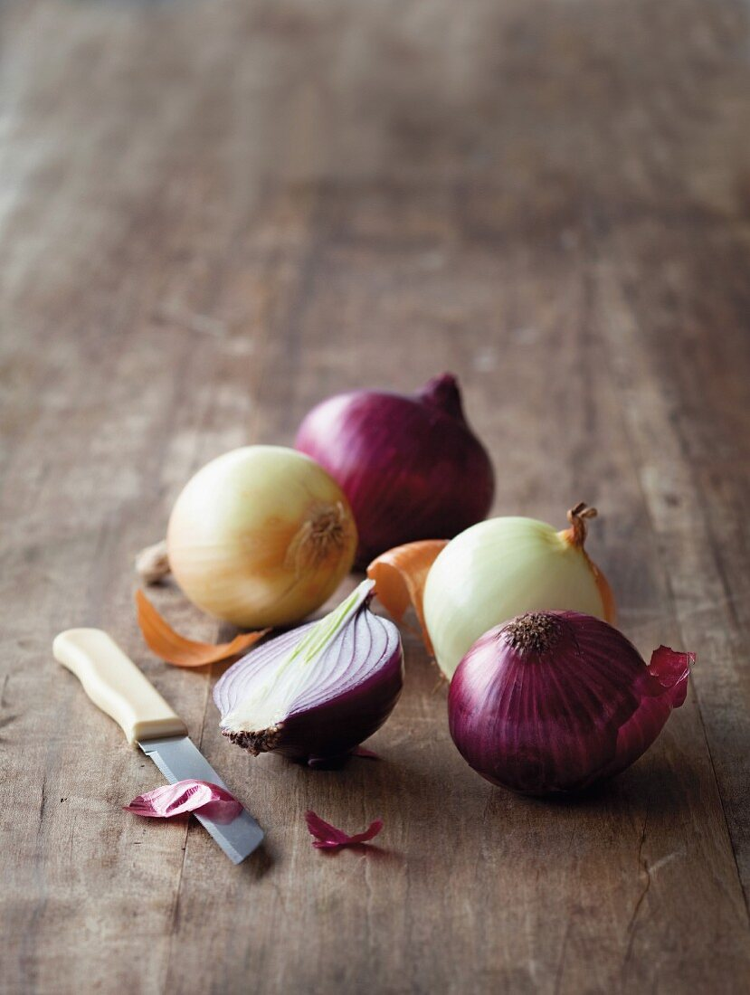 An arrangement of onions featuring a halved onion