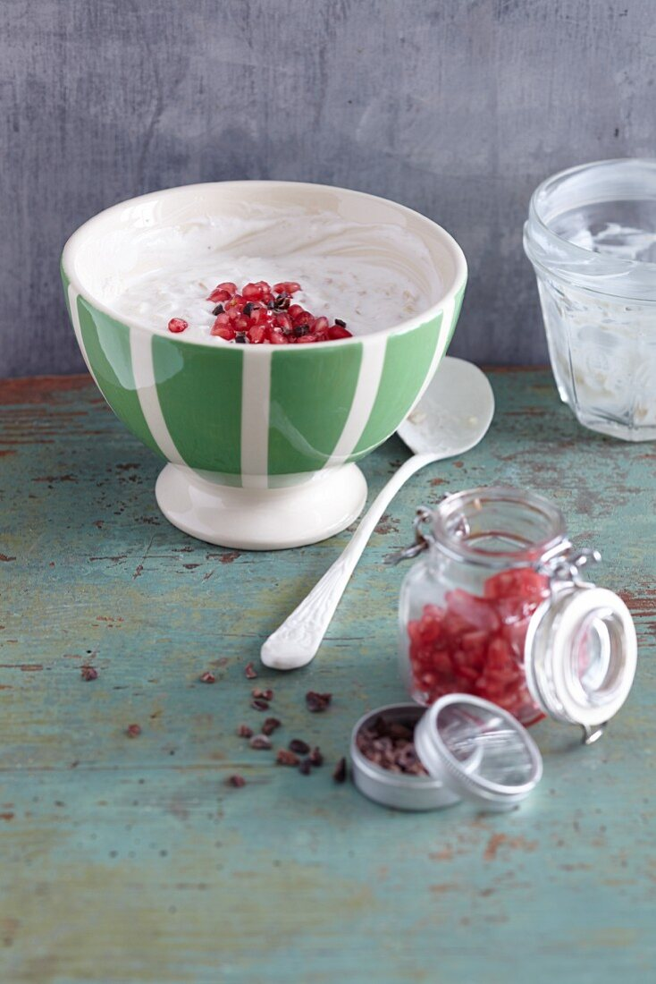 Overnight oats with lucuma powder, pomegranate seeds and cocoa nibs