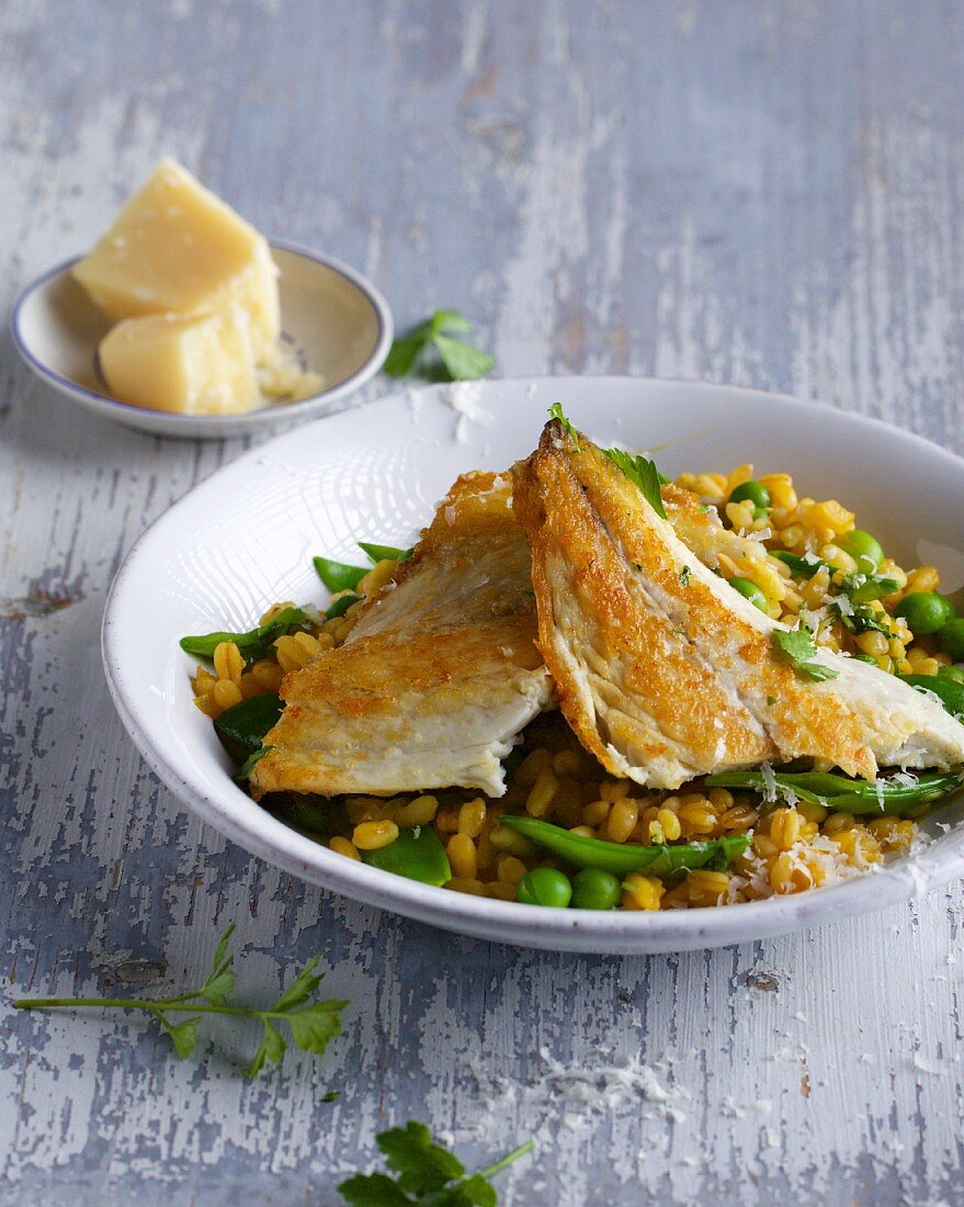 Seabream fillet with a carrot and wheat risotto