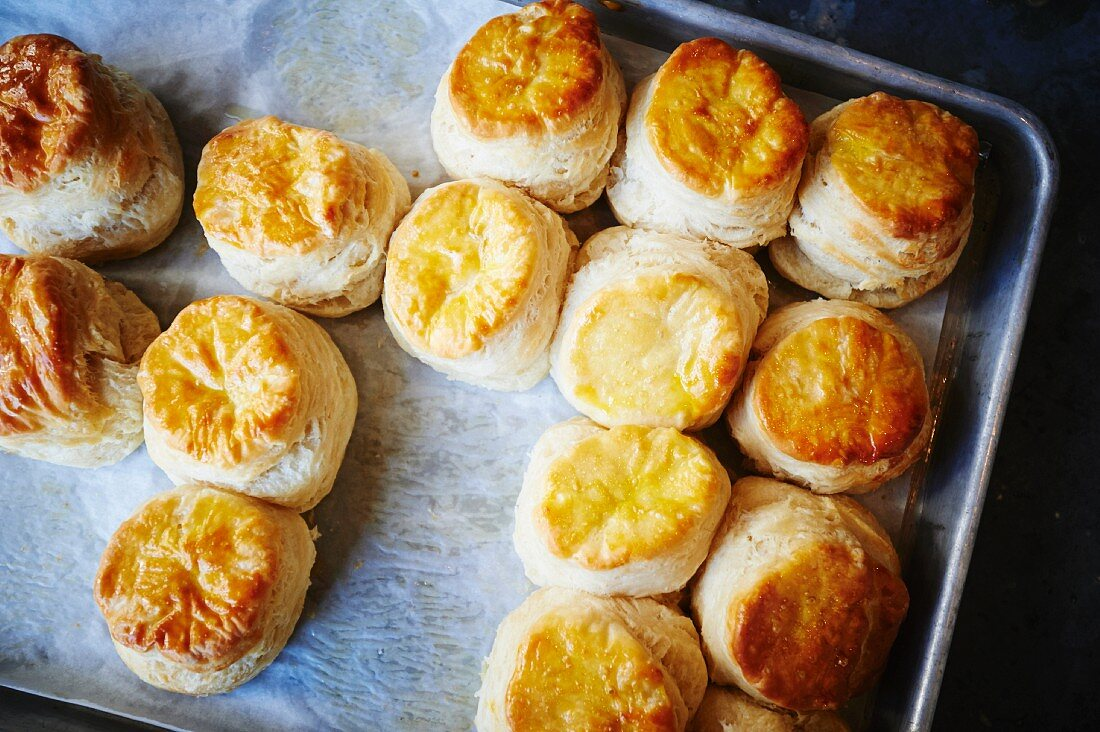 Freshly baked American biscuits on a baking tray