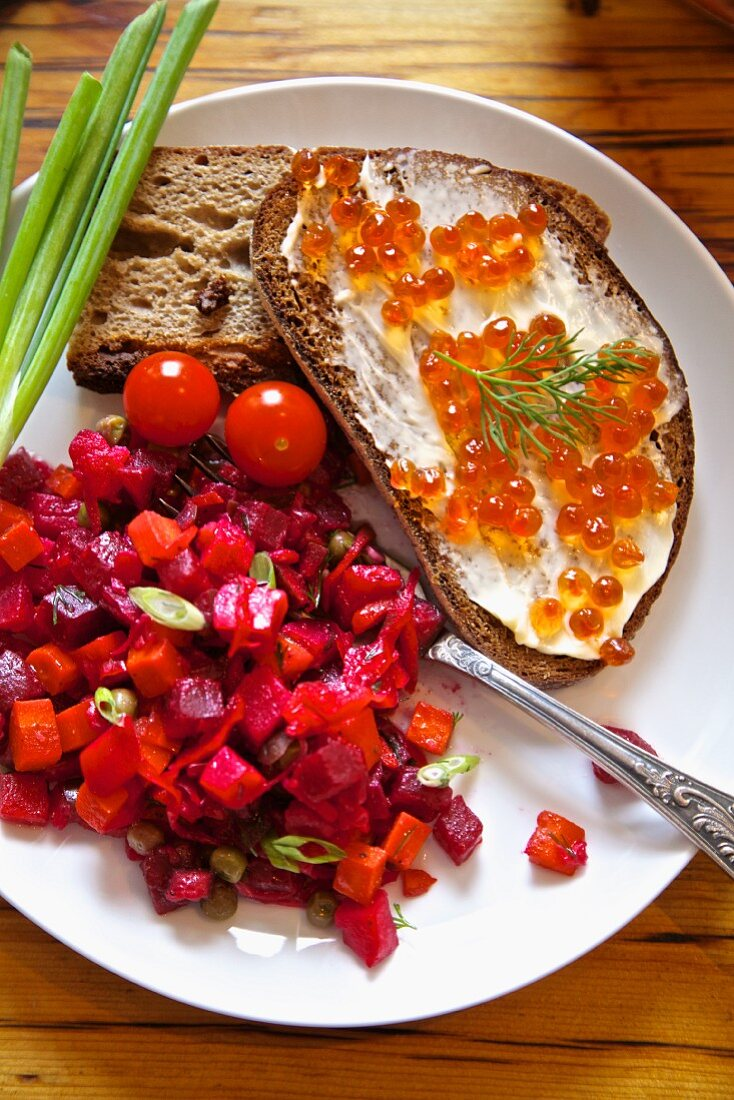 Beetroot salad with bread and butter with salmon caviar (Russia)