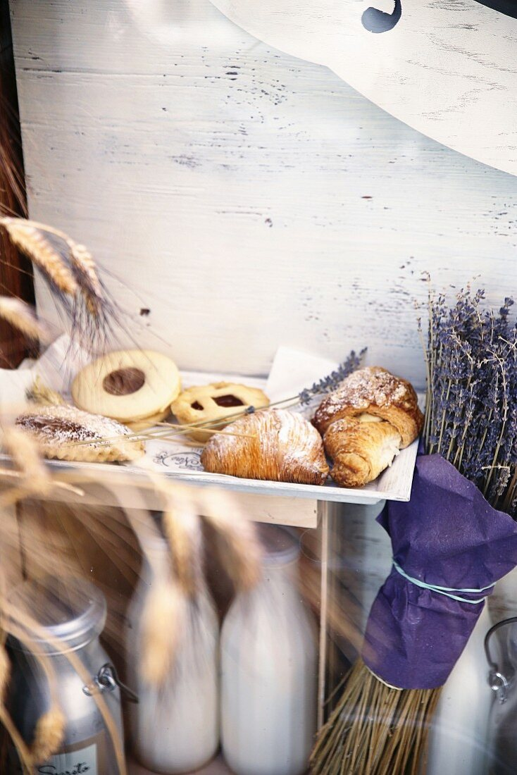 Italian biscuits and pastries next to a bunch of dried lavender