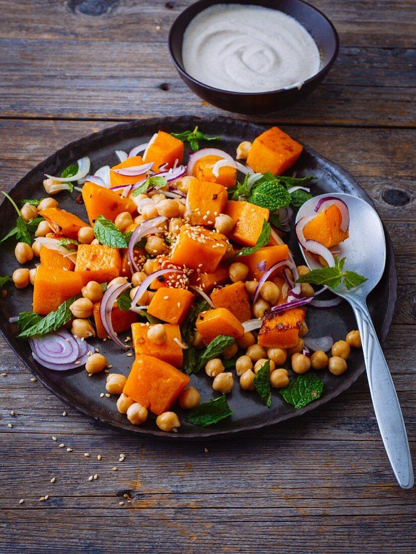 Warm pumpkin salad with chickpeas and yoghurt