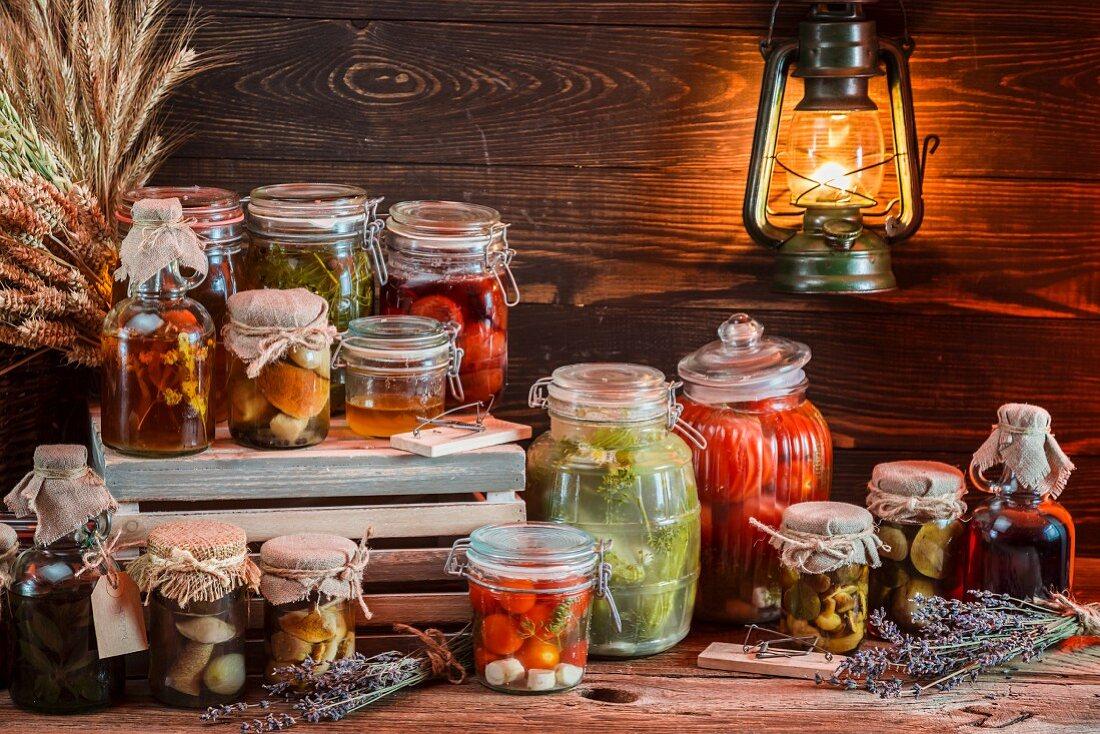 Various jars of preserved mushrooms and vegetables