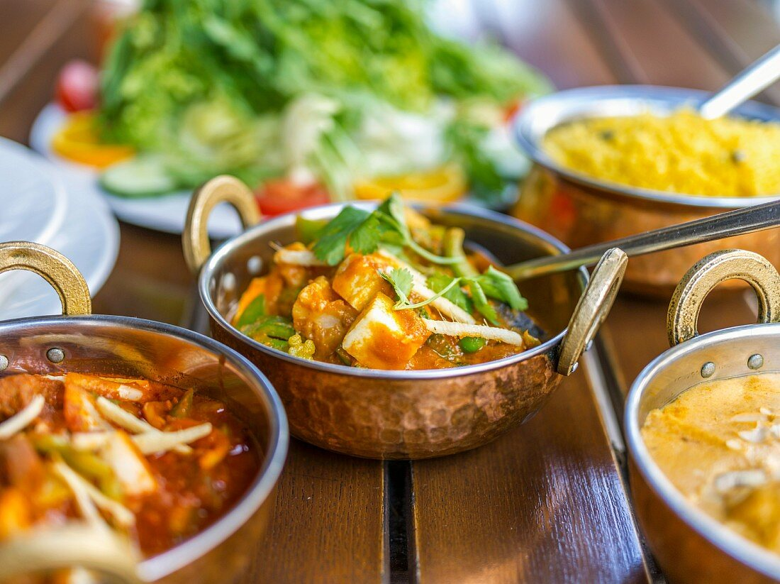 Vegetable curries with rice in an Indian restaurant