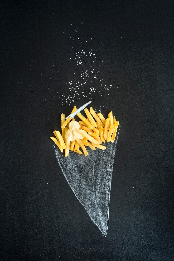 Chips with mayonnaise 'in' a painted cone