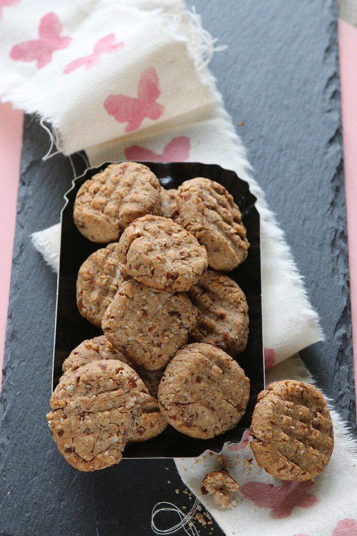 Gluten-free shortbread biscuits on a hand-printed ribbon and a slate platter