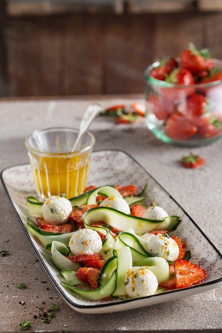 Vegan cashew nut cheese with strawberries and courgette pasta