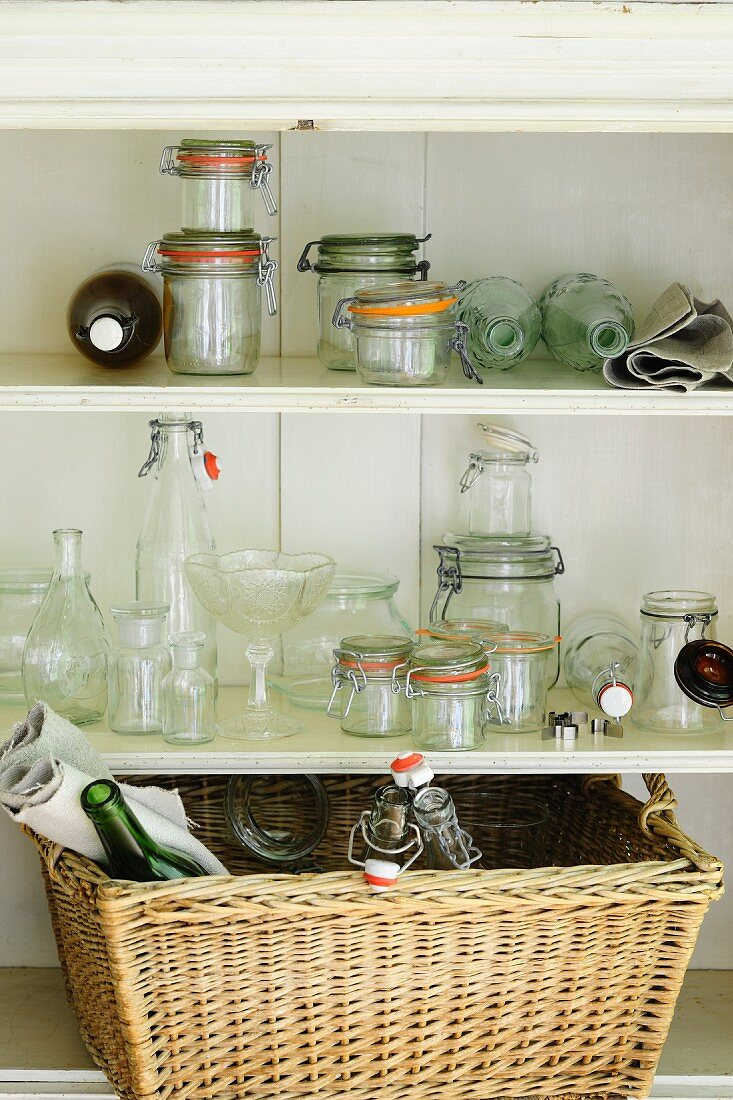 Empty preserving jars and bottles in pantry