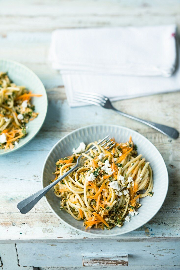 Carrot pasta with feta cheese pesto and almonds