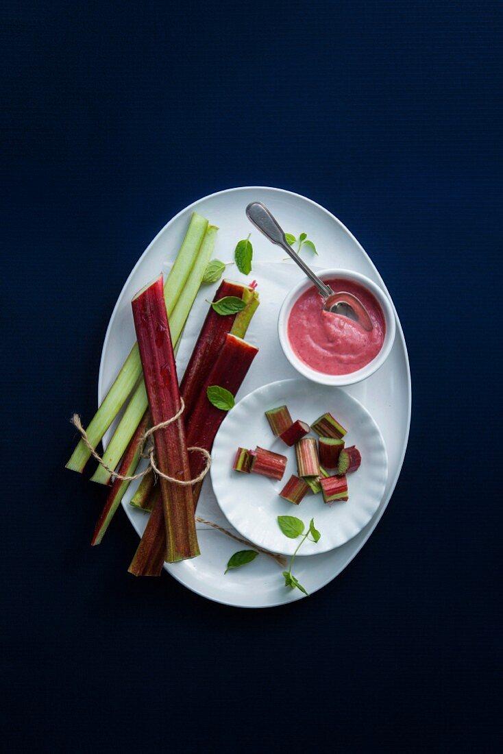 Rhubarb sauce and fresh rhubarb