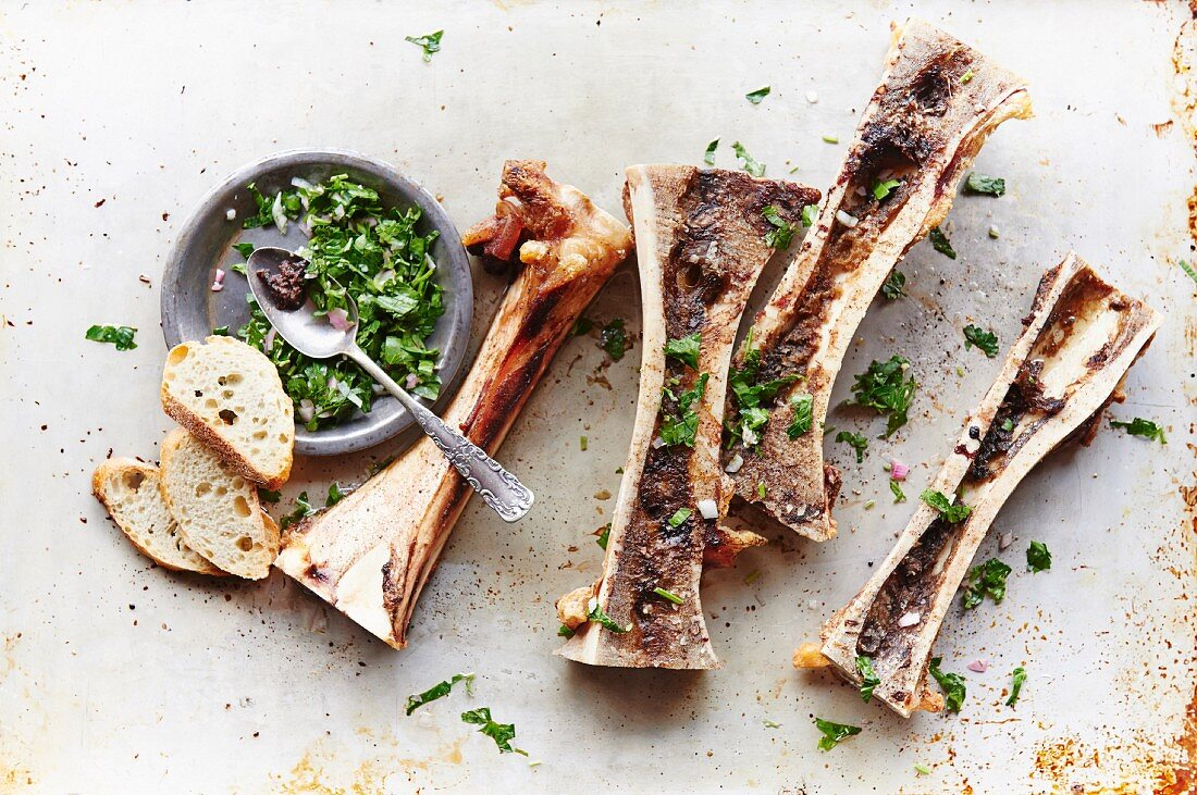 Roasted marrow bones with a parsley, shallot and lemon juice germolata seasoned with salt and pepper