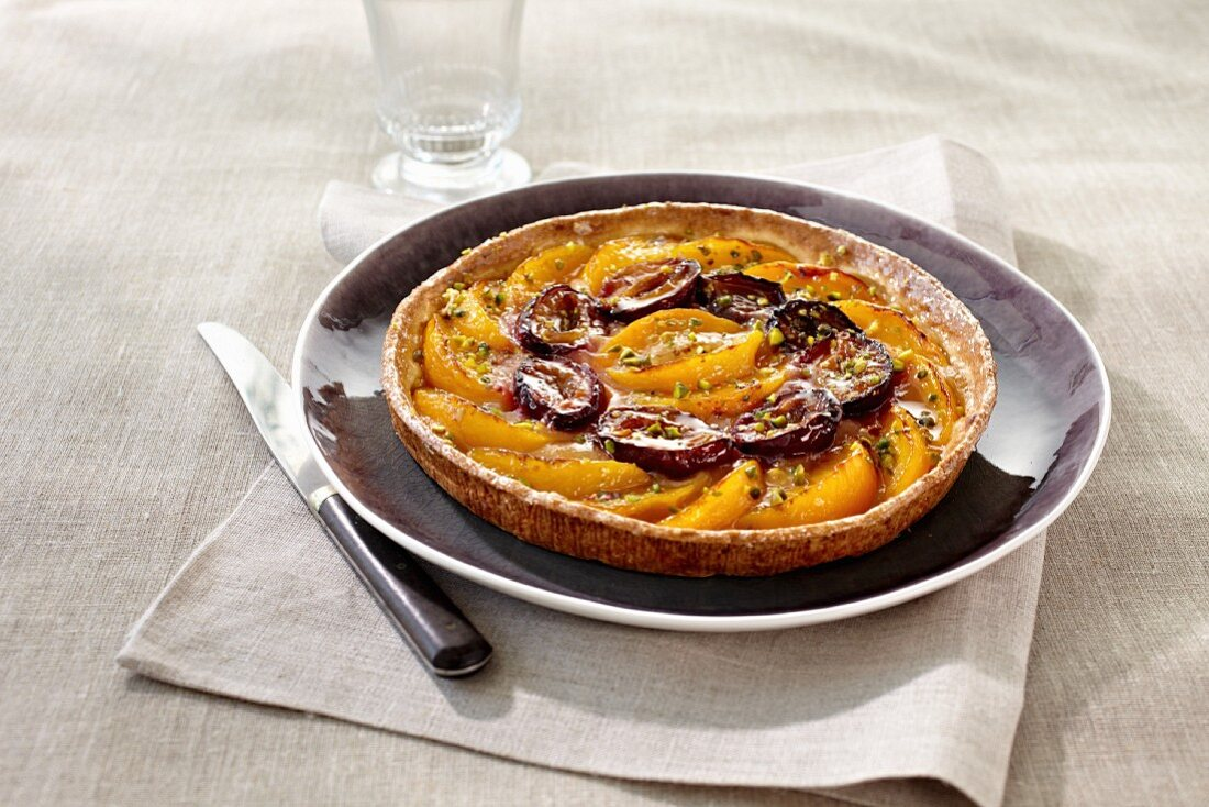 Peach and damson tart