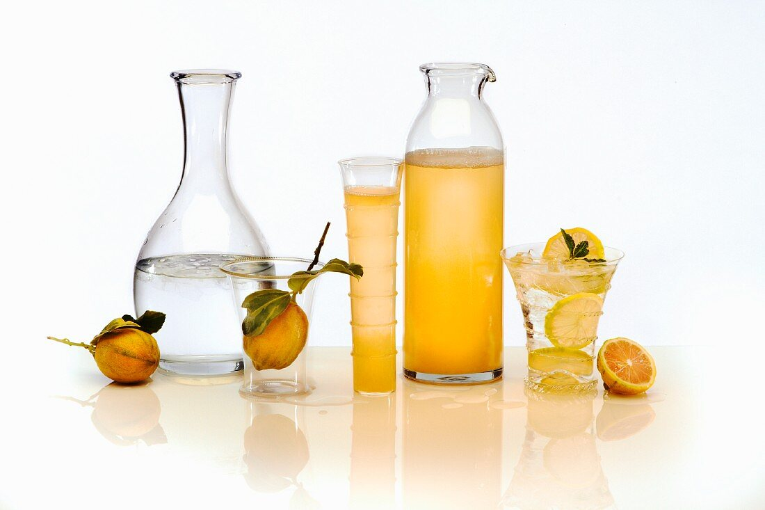 Lemon juice and water in glasses and carafes