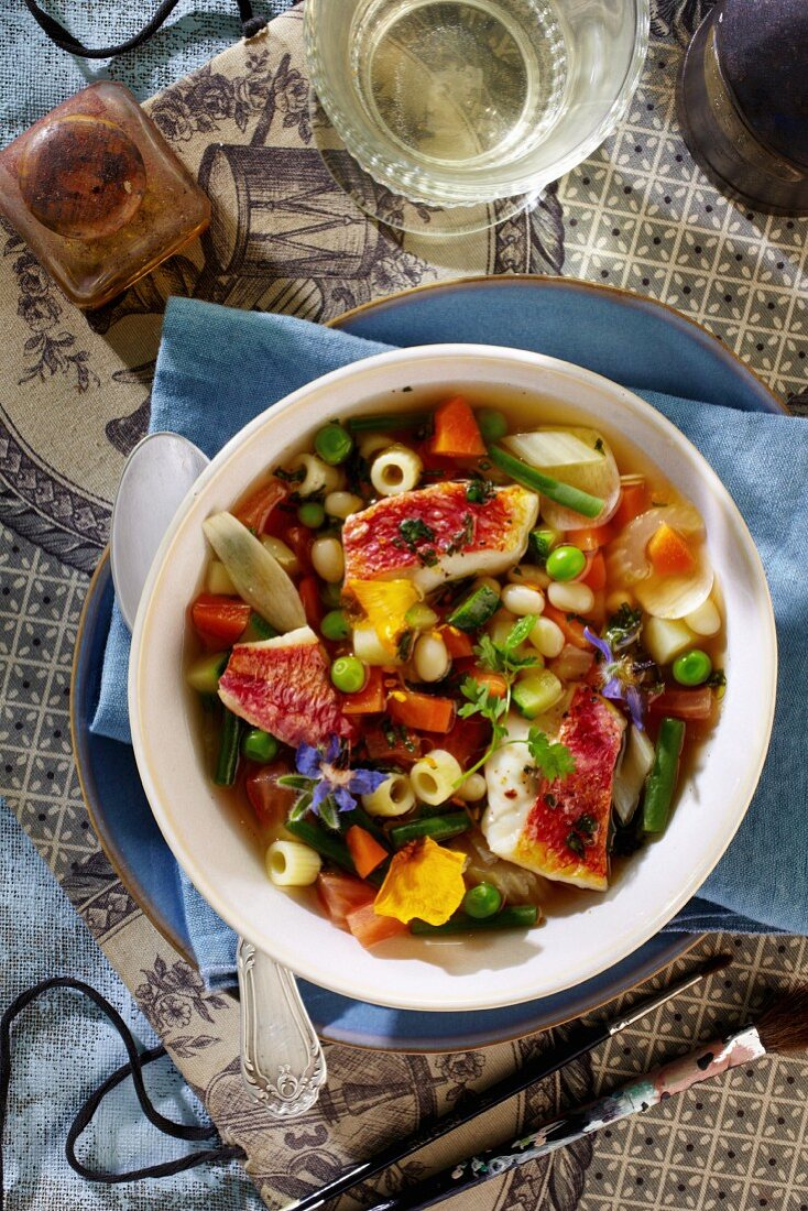 Colourful minestrone with red mullet and edible flowers