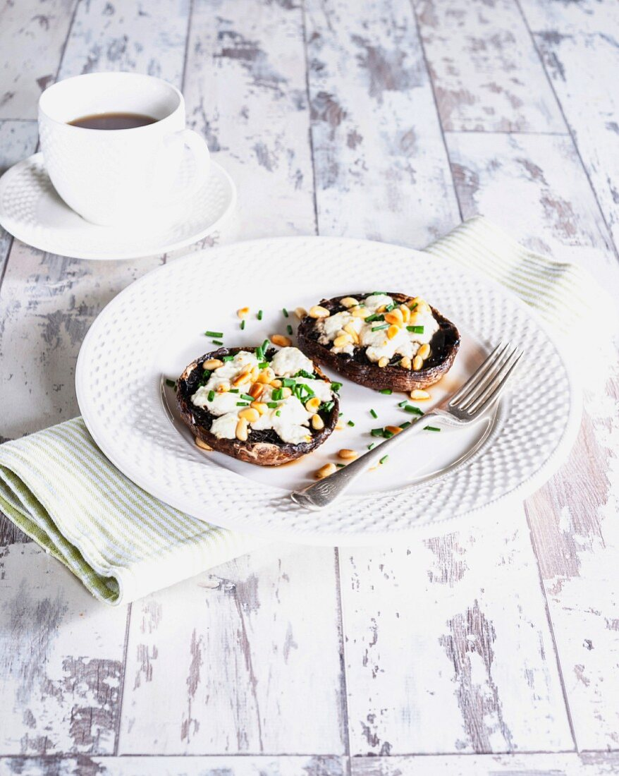 Gratinated portobello mushrooms with goat's cheese and pine nuts