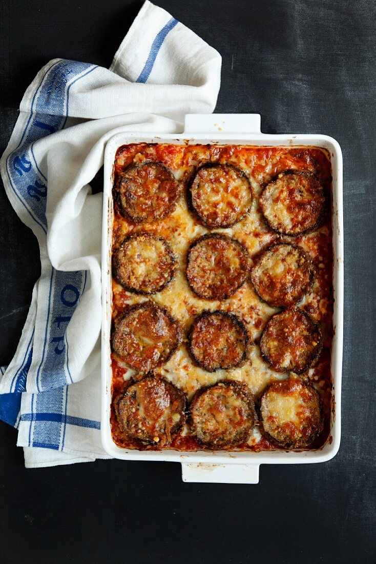 Aubergine bake with tomato sauce and melted cheese (seen from above)