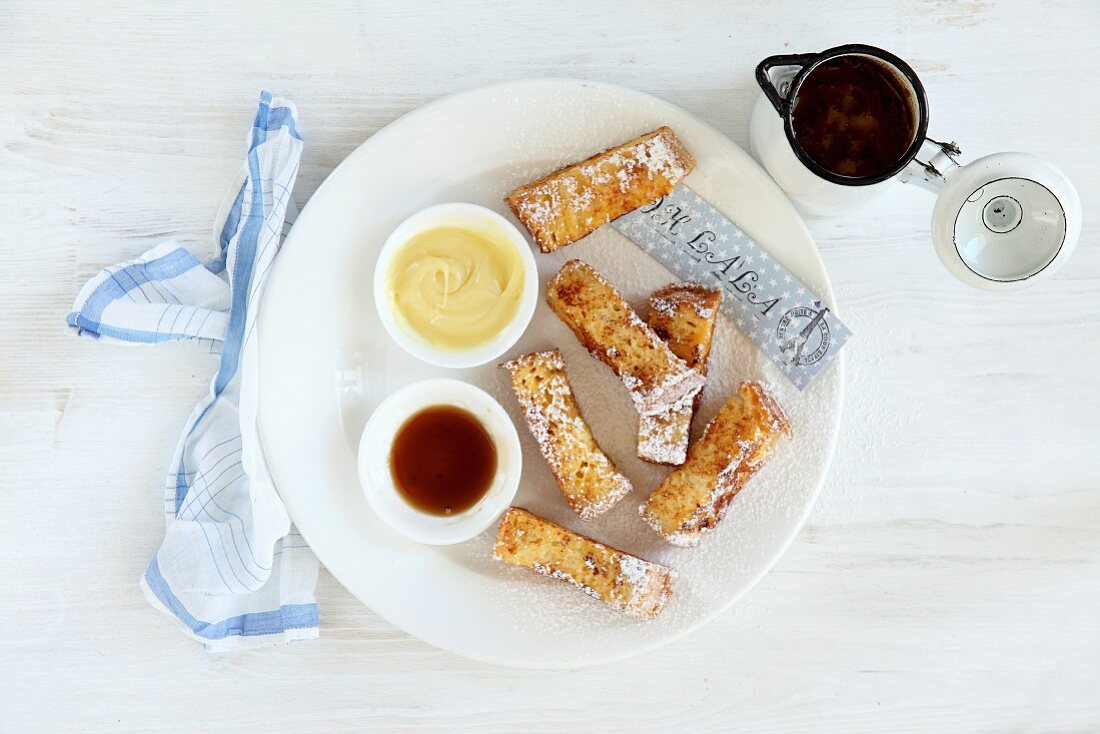 French toast sticks with maple syrup and white chocolate (seen from above)