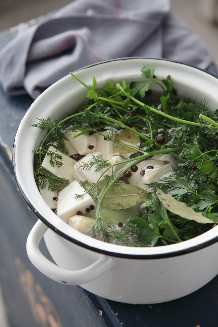 Fresh vegetables and herbs in a pot