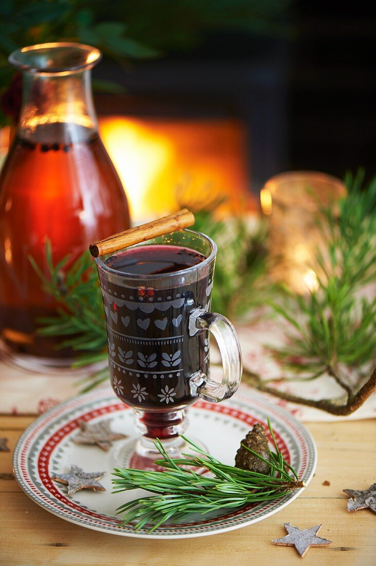 Mulled wine with a cinnamon stick for Christmas
