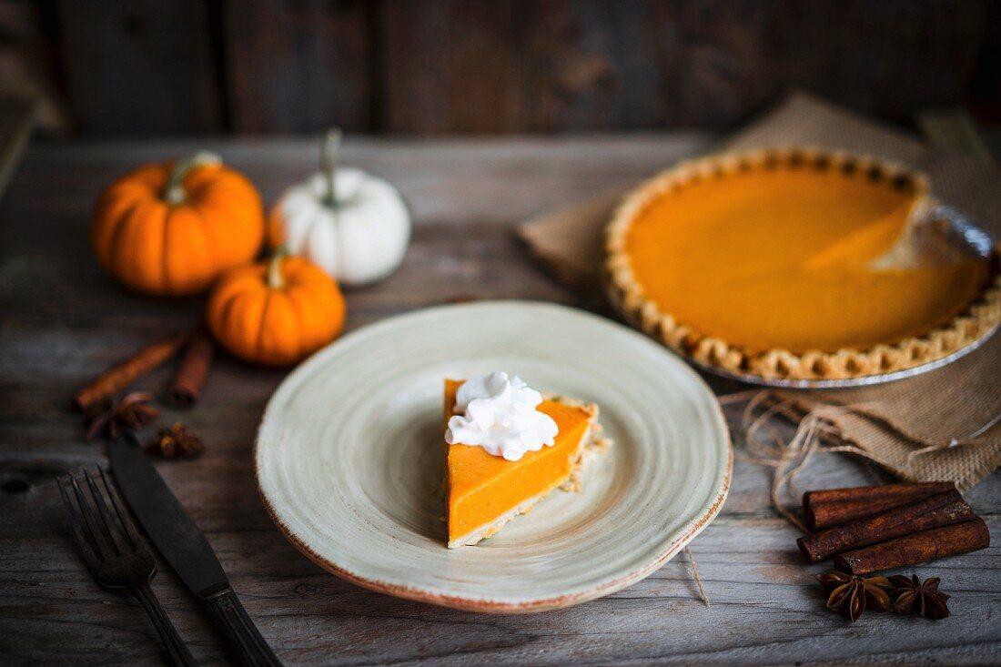 Pumpkin pie on rustic wooden surface