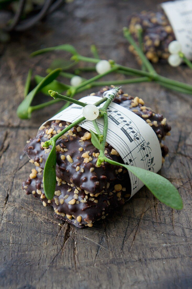 German gingerbread biscuits with slivered almonds and a sprig of mistletoe