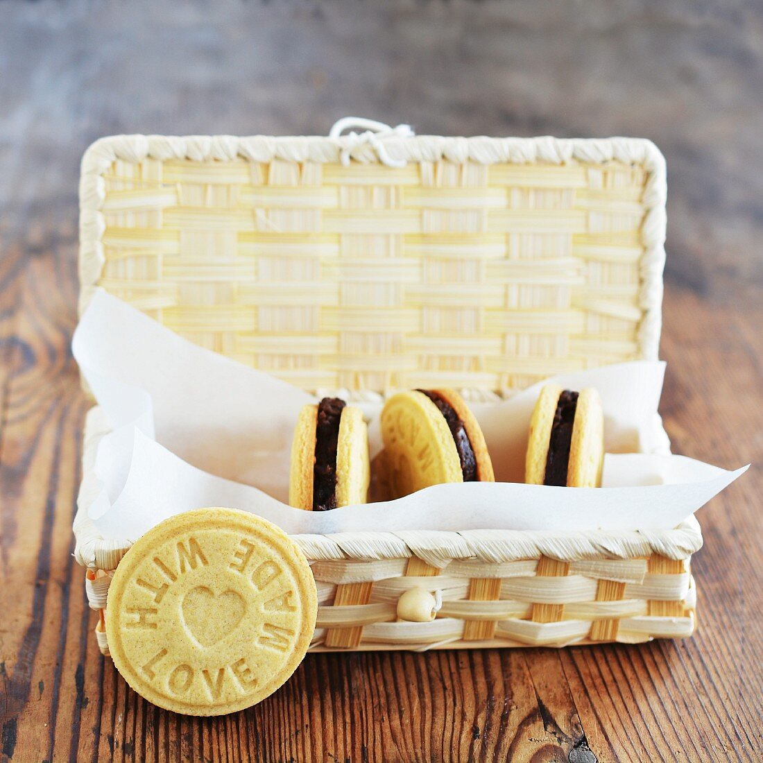Homemade biscuits with chocolate cream in a gift basket