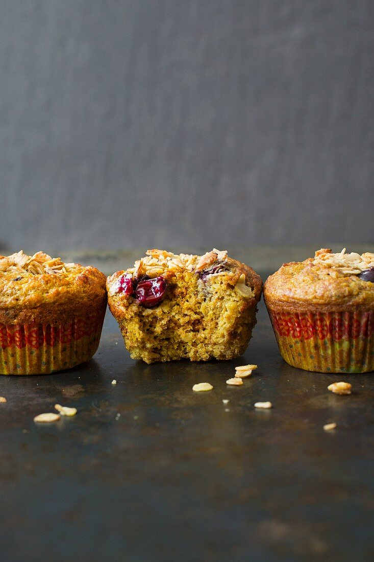 A row of turmeric muffins