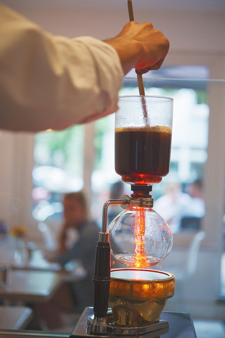 Filter coffee being made with a syphon in the 'Stockholm Espresso Club' in Hamburg