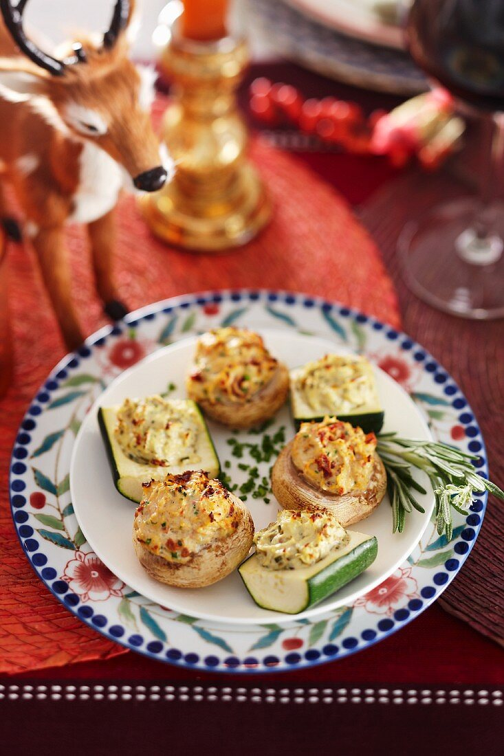 Stuffed gratinated courgettes and mushrooms