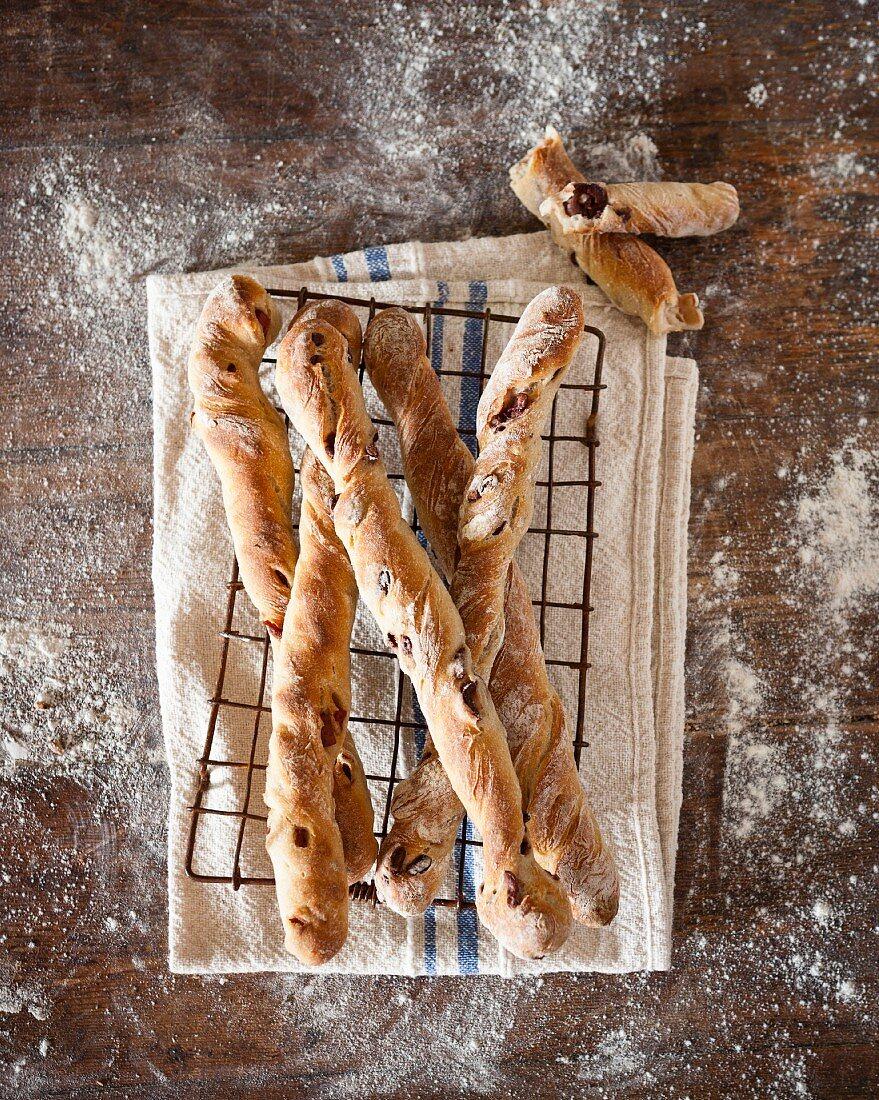 Homemade breadsticks with olives