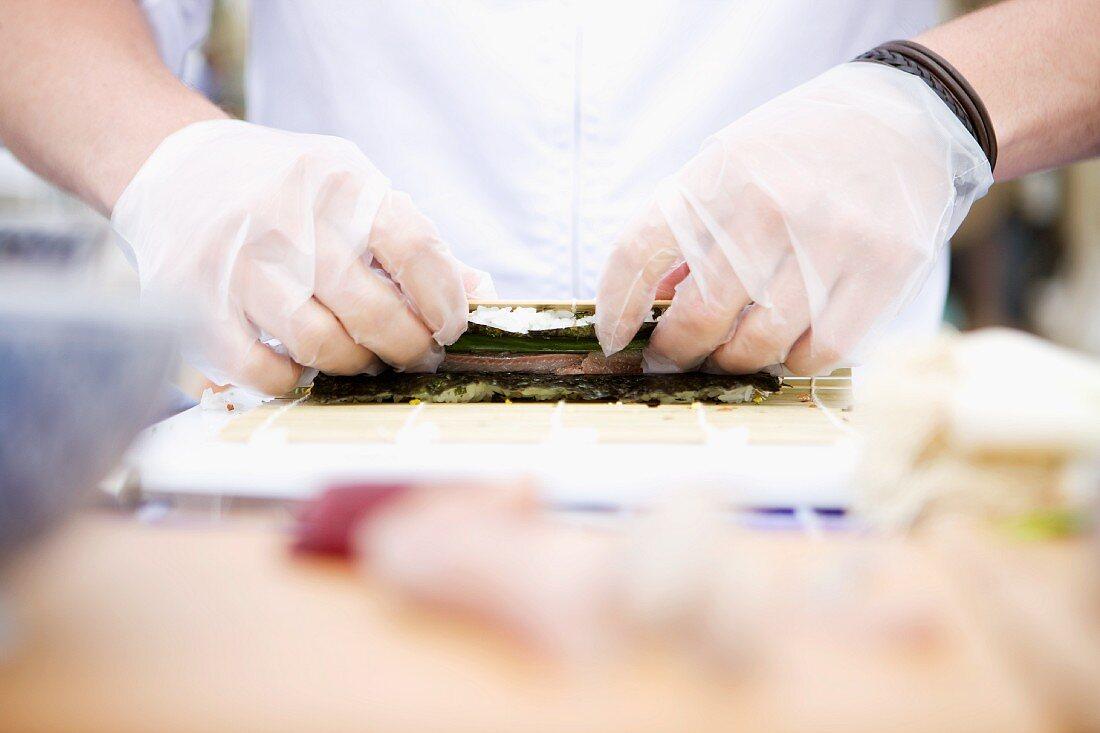 Sushi being made