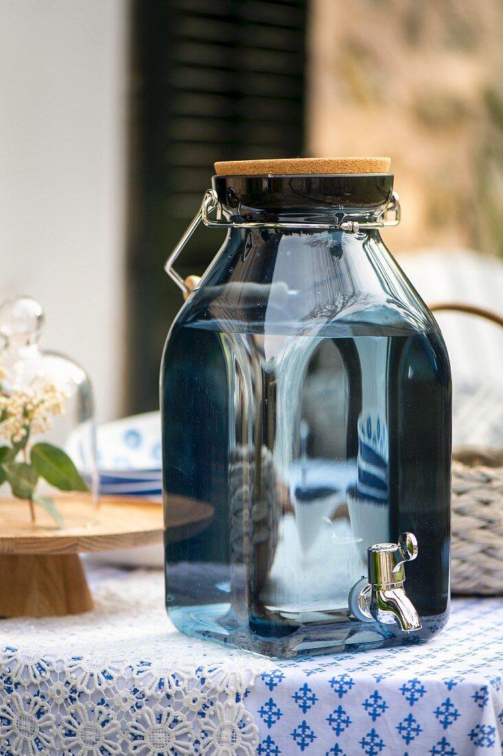 Blue glass drink dispenser