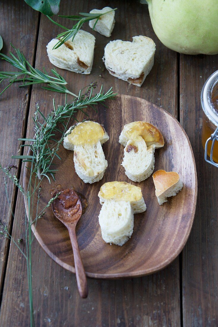Mushroom shapes cut out of yeast dough and covered in quince jam