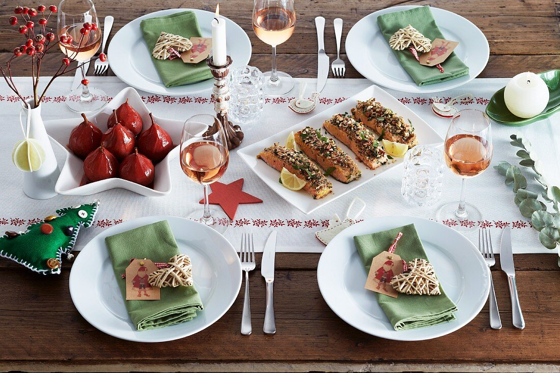 Various dishes on a table laid for Christmas