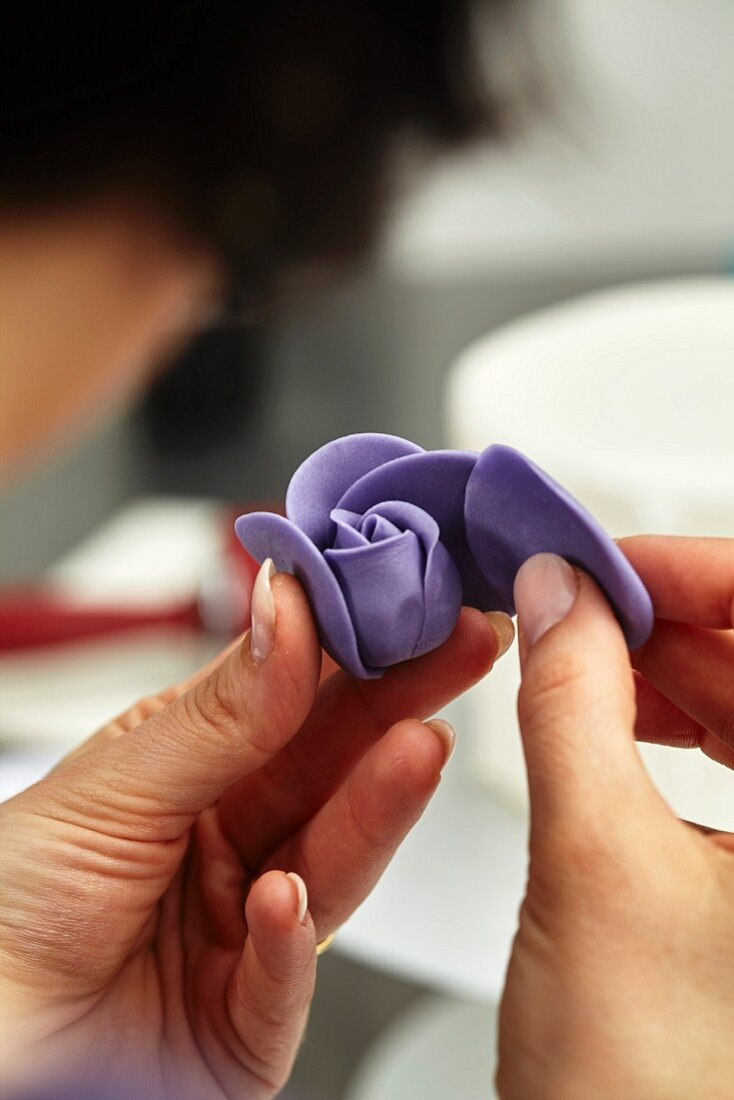 A confectioner making a marzipan flower