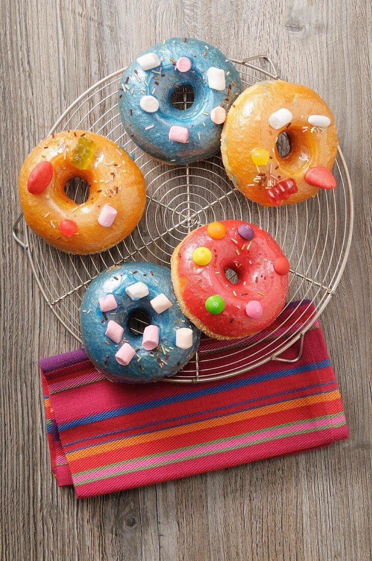 Doughnuts with coloured sugar glaze