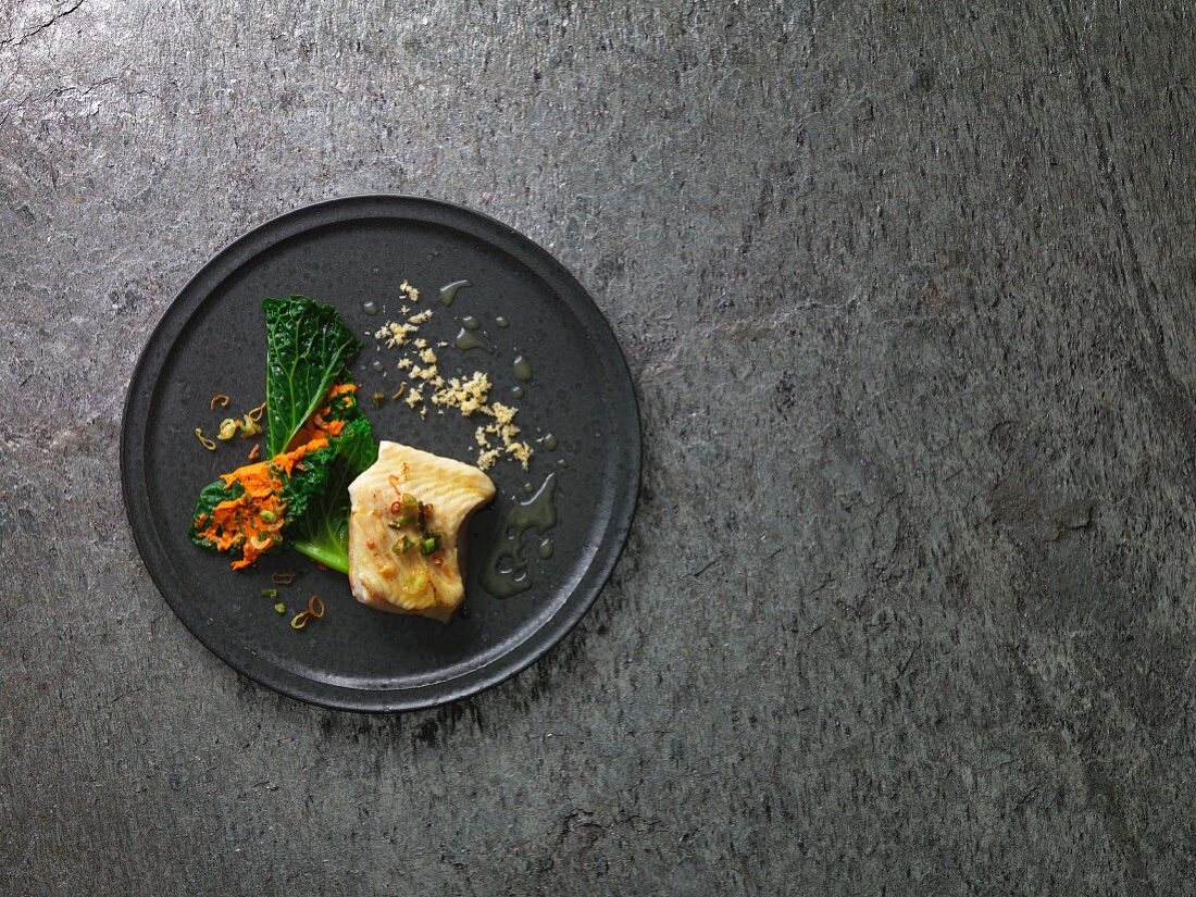 Steamed sturgeon fillet with an elderflower emulsion and savoy cabbage