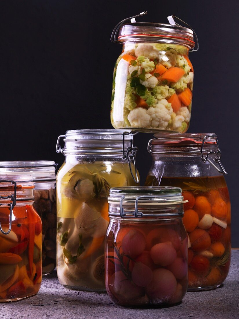 Preserved fruit and vegetables in flip-top jars