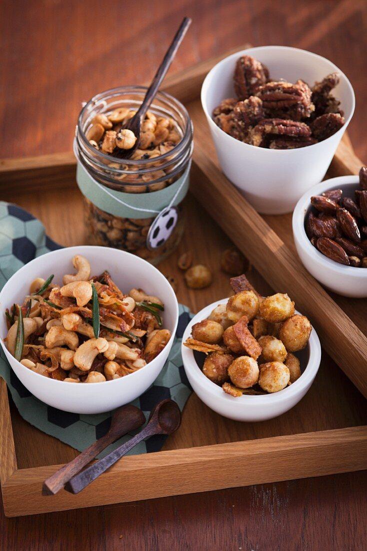 A variety of seasoned nuts