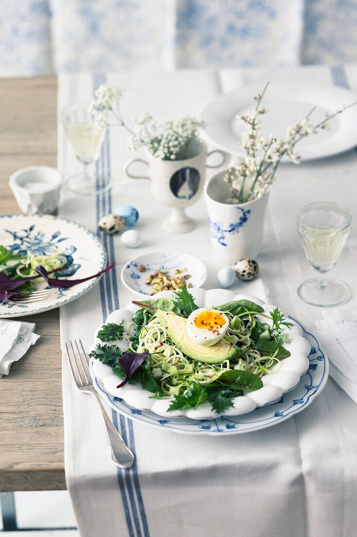 Courgette and apple salad with avocado and egg for Easter