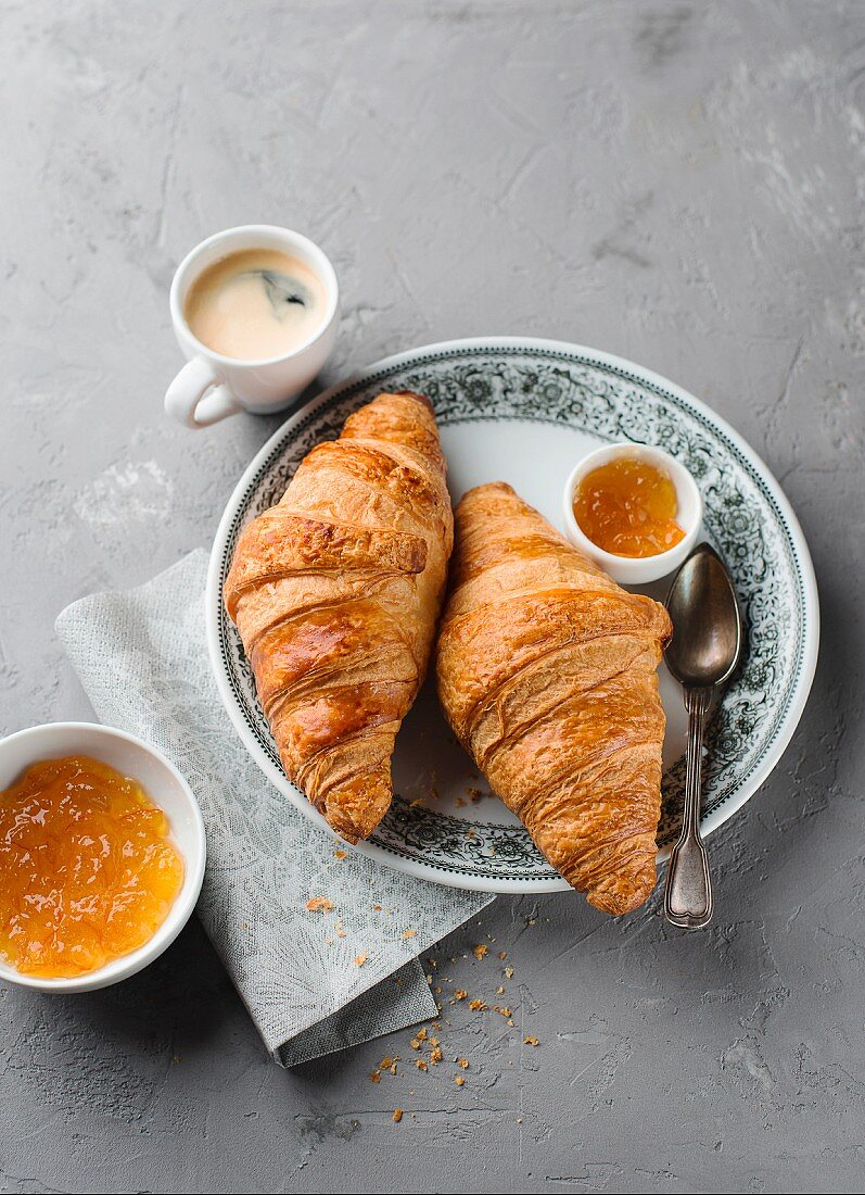 Croissants with marmalade and coffee