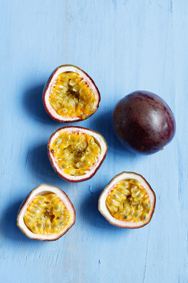 Fresh passion fruits, whole and halved