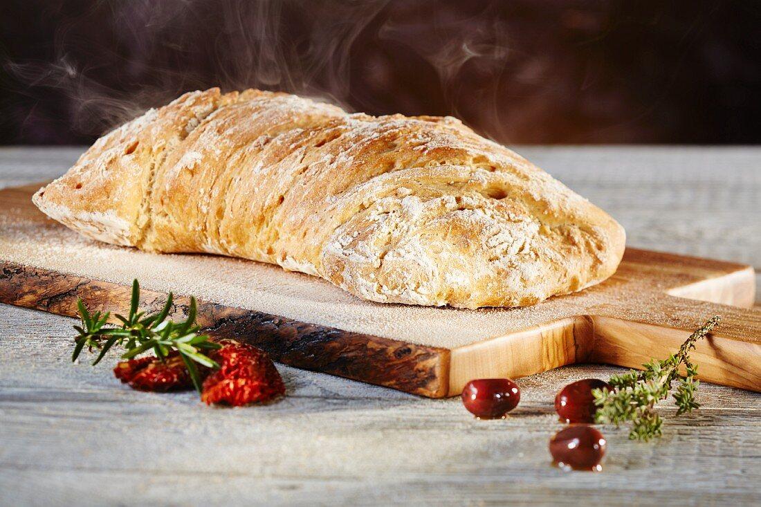 Ciabatta bread on an olive wood board