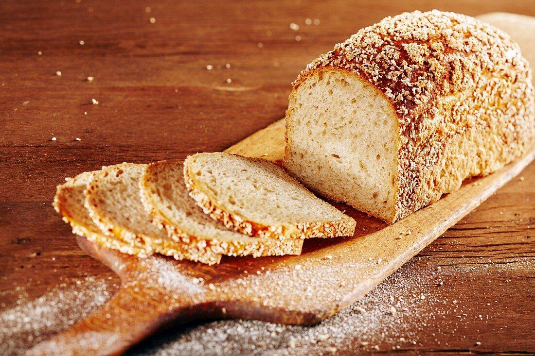 Spelt bread, sliced, on a chopping board